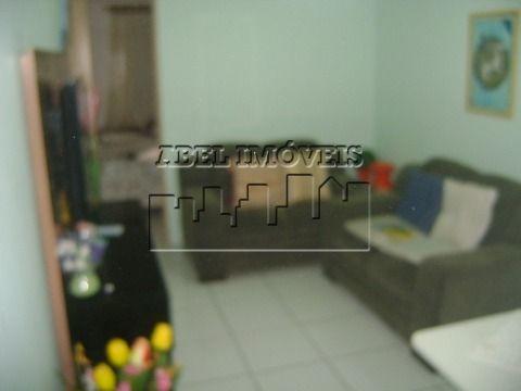 Sala living dividido reformado em São Vicente