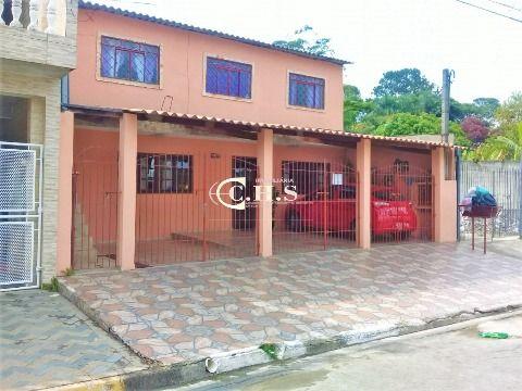 Terreno com 5 casas à venda