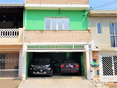 Terreno com 2 casas para venda