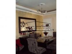 Apartamento contendo 2 dormitórios com armários planejados , sala, cozinha com móveis planejados.