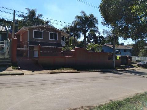 Amplo terreno com casa em Fazenda Rio Grande.
