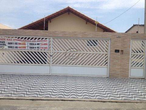 Casa de Condomínio localizada no bairro Maracanã - Praia Grande/SP.