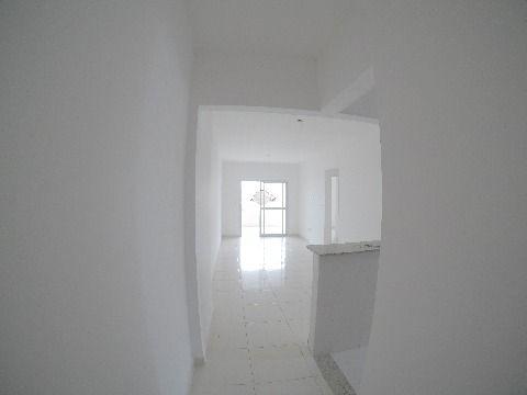 Apartamento na Guilhermina dois dormitórios com suite e duas vagas.