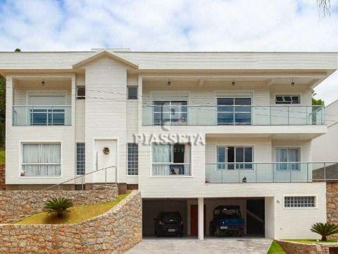 Casa semi mobiliada 4 suítes condomínio fechado no Itacorubi Florianópolis