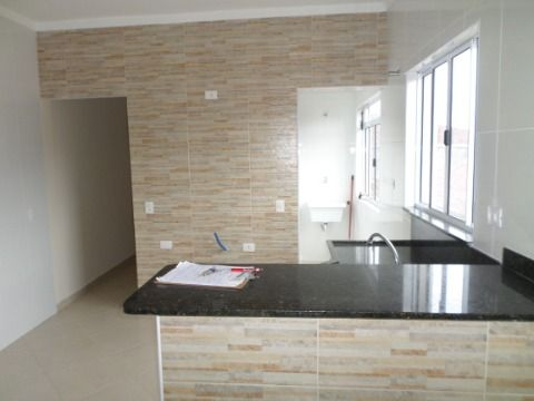 Casa Sobrepostas 2 dormitórios  sendo 1 suite em Praia Grande -Jardim Imperador