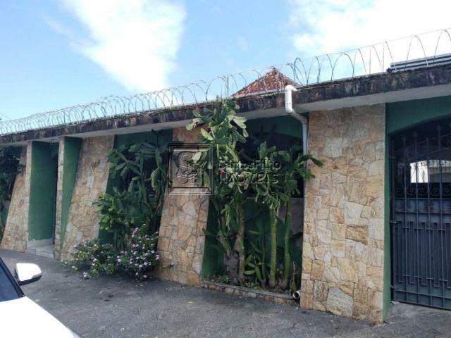Casa6 dormitórios em Praia Grande
